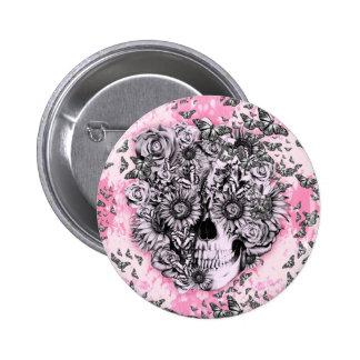 Crânio feminino do rosa e o branco da borboleta botons