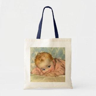 Criança das crianças do vintage, bebé bonito na sacola tote budget