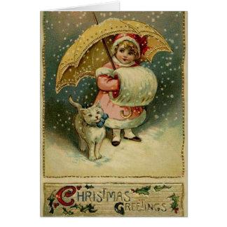 Criança e gato do Victorian no cartão de Natal da