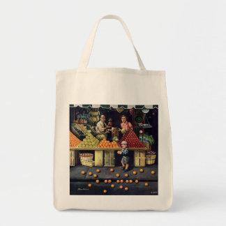 Criança e laranjas bolsa para compra