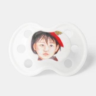 Criança leste asiático chupeta para bebê