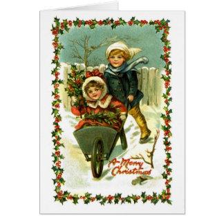Crianças do cartão do natal vintage na neve