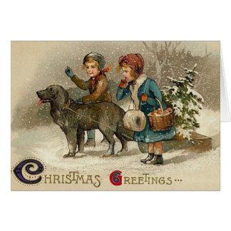 Crianças do Natal do Victorian e cartão do cão