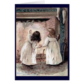 Crianças que esperam o cartão de Papai Noel