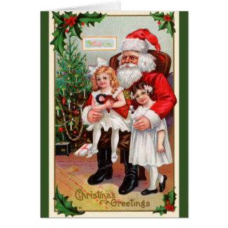 Crianças que sentam-se em cartões de natal do