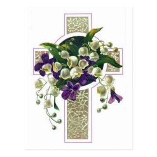 Cruz de prata com flores roxas cartão postal