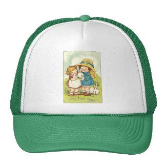 Cumprimento da páscoa das crianças e dos coelhos boné