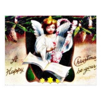 Cumprimento do Natal com o anjo que joga a música Cartoes Postais