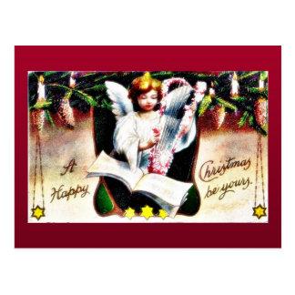 Cumprimento do Natal com o anjo que joga a música Cartão Postal