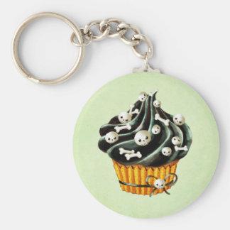 Cupcake preto do Dia das Bruxas com crânios Chaveiro