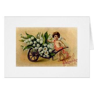 Cupido do Victorian com o cartão do dia dos