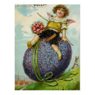 Cupido lindo no ovo da páscoa cartão postal