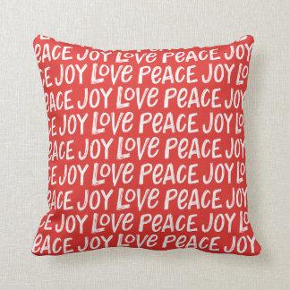Da paz indicada por letras da alegria da mão almofada