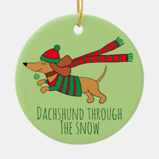 Dachshund através do ornamento do círculo da neve