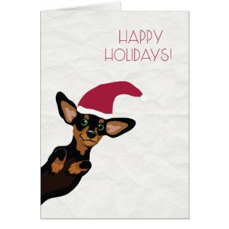 Dachshund bonito com o cartão do feriado do chapéu