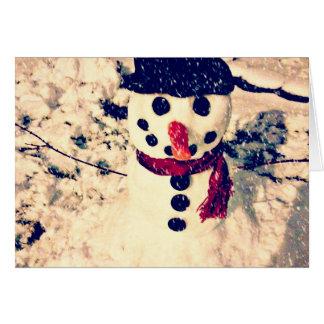 Deixais lhe para nevar cartão do feriado do boneco