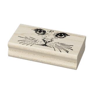 Desenho da cara do gato com as suiças longas do carimbo de borracha