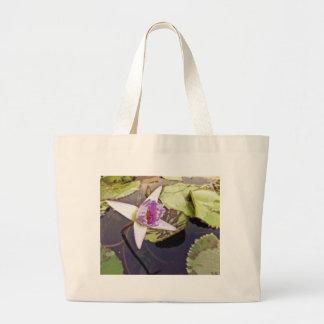 Desenho roxo da flor de Lotus Bolsas