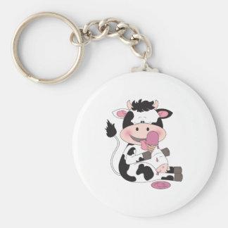 Desenhos animados bonitos da vaca do bebê com seu chaveiro