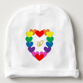 Desenhos animados coloridos dos corações e das gorro para bebê