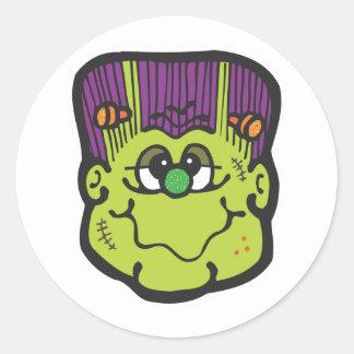 desenhos animados da cara do frankenstein adesivo redondo