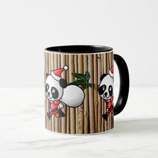 Desenhos animados da panda do papai noel & caneca
