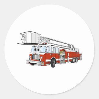 Desenhos animados do carro de bombeiros de gancho adesivos redondos
