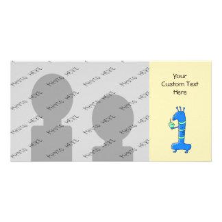 Desenhos animados do primeiro aniversario, no azul cartão com foto
