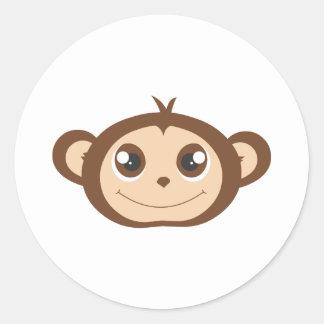 Desenhos animados felizes bonitos do macaco adesivos redondos