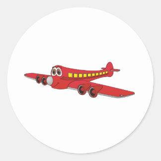 Desenhos animados vermelhos do avião de passagem adesivos em formato redondos