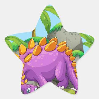 Dinossauro roxo que está na terra adesito estrela