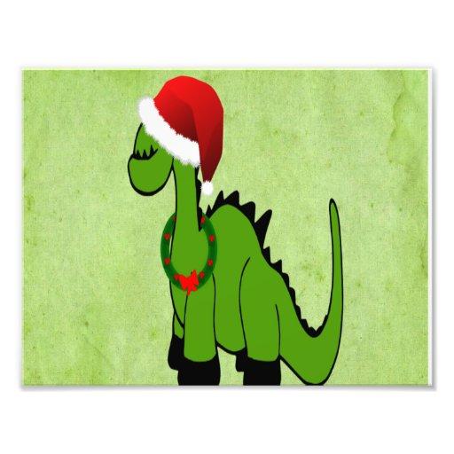 Dinossauro verde em um chapéu do papai noel para o foto artes