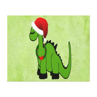 Dinossauro verde em um chapéu do papai noel para o impressão de canvas envolvida