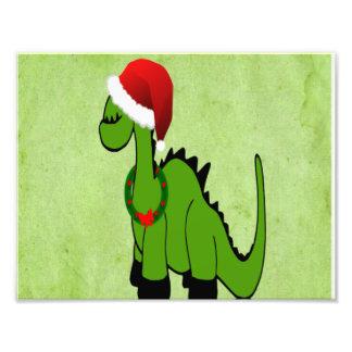 Dinossauro verde em um chapéu do papai noel para o impressão de foto