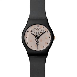 Do símbolo médico do Caduceus do relógio da