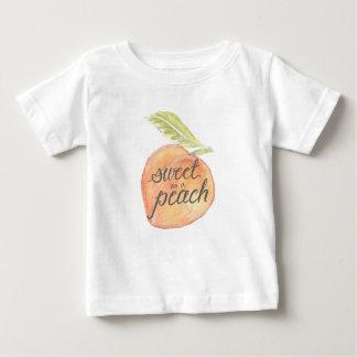 Doce como uma camisa da criança do pêssego