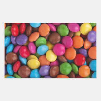 Doces coloridos dos skittles adesivo retangular