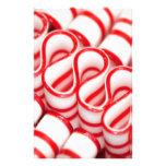 Doces vermelhos e brancos antiquados da fita papelaria