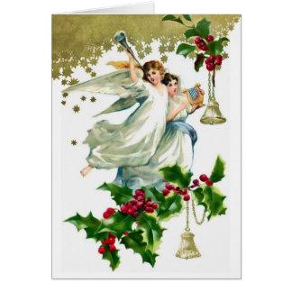 Dois anjos do Natal com cartão de Bels
