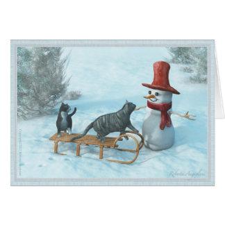 Dois gatos e um cartão do boneco de neve