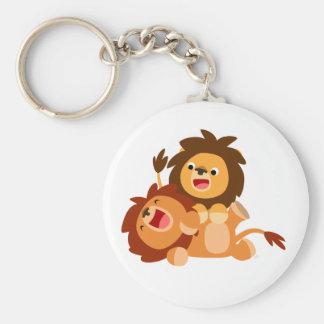 Dois leões brincalhão bonitos dos desenhos chaveiro