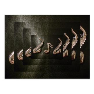 Dois saxofones com nota musical cartao postal