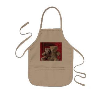dois ursos de ursinho em um vermelho presidem o avental infantil