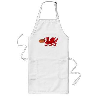 Dragão de Galês com um avental da cozinha da bola