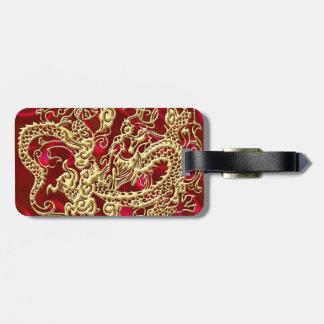 Dragão gravado do ouro no impressão vermelho do etiqueta de bagagem
