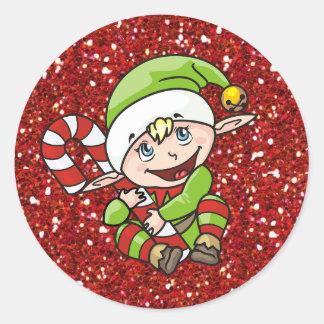 Duende do Natal com etiquetas do bastão de doces