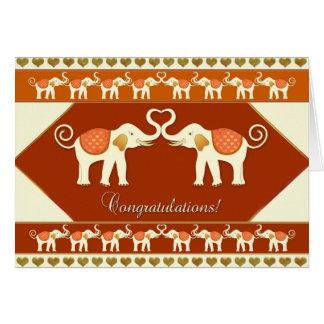 Elefantes brancos no cartão dos parabéns do amor