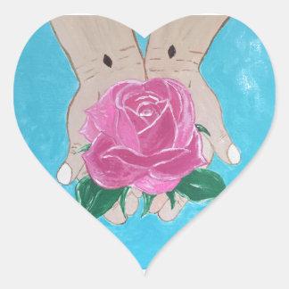 Em suas mãos adesivo coração