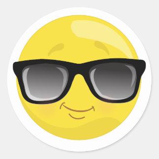Emoji que veste etiquetas dos óculos de sol