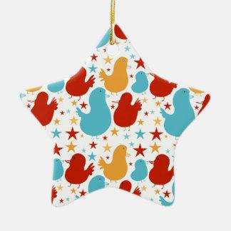 Enfeites de natal doces dos pássaros da estrela